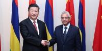 习近平会见毛里求斯总理 - 中国山东网